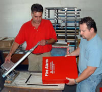 Mier Products can silk-screen your logo or graphic to your metal enclosure: Step 4, Ink is applied and dried.